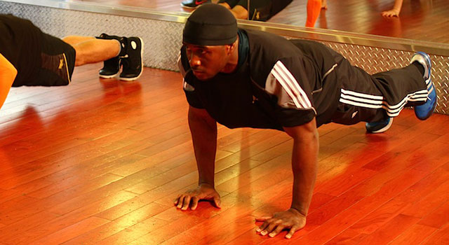 Reggie Bush demonstrating a push up plank