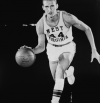 Jerry West playing basketball