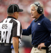 NFL referee and Pete Carroll