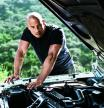 Vin Diesel fixing a car