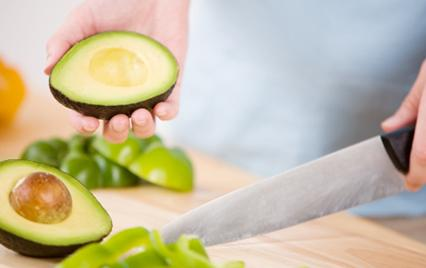 man slicing and avocado