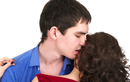 Man whispering in woman&#039;s ear