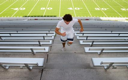 Man running up stadium steps