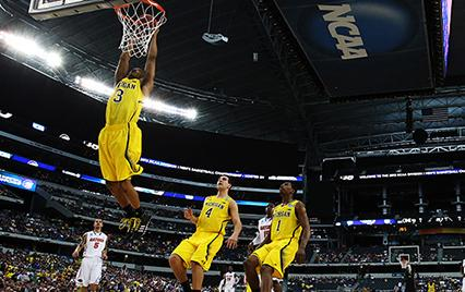 Michigan&#039;s Trey Burke dunking basketball 