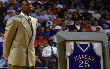 Danny Manning standing next to his jersey