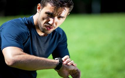 Man checks pulse after run