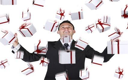 Man in suit throwing presents in the air