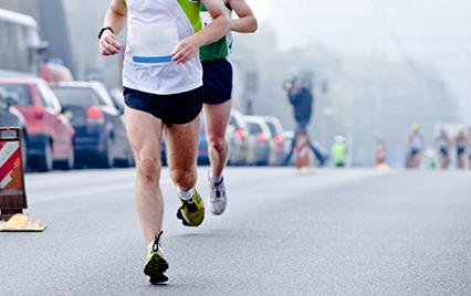 two men running a road race