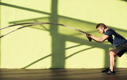 Man training with battling ropes