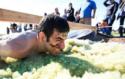 man doing a tough mudder adventure race