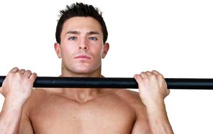 man with pull up bar doing abs exercises