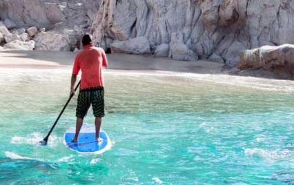 man on stand up paddleboard