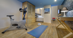 Hotel room with fitness equipment