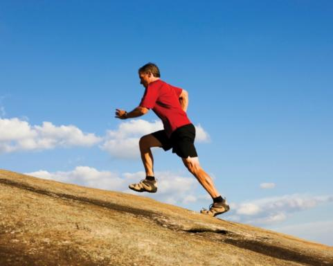 man running up hill