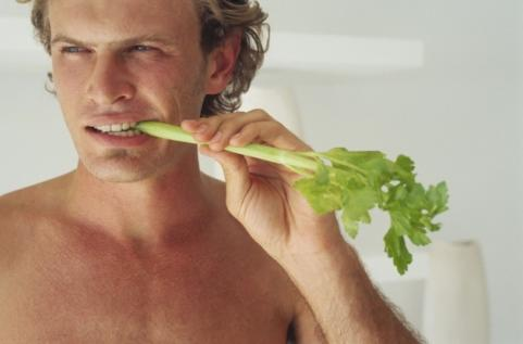 Man eating celery