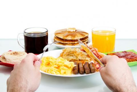 Man eating big breakfast 