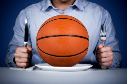 Man eating with basketball on plate