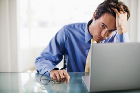 Man stressed out at computer