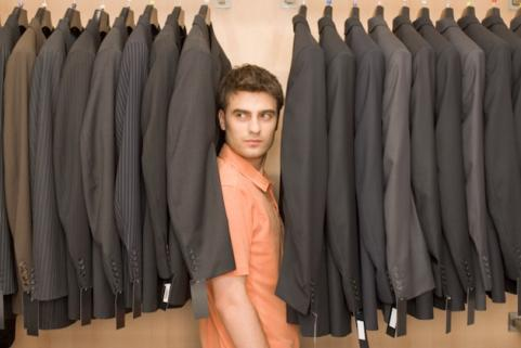 Man in row of suits