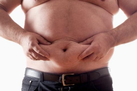 Man holding stomach fat