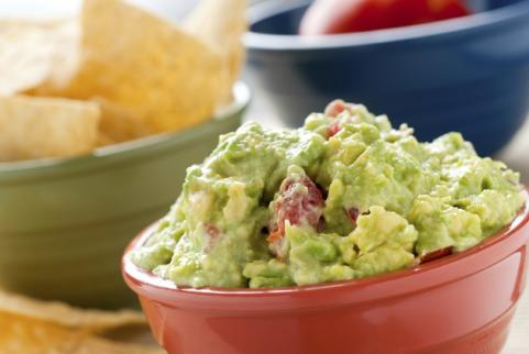bowl of guacamole with tortilla chips