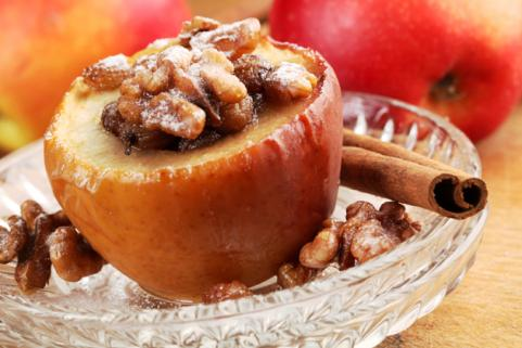 Baked apple stuffed with nuts and raisins
