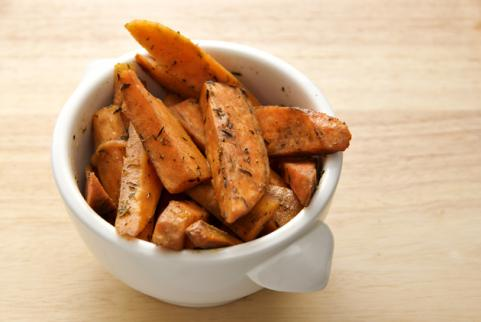 bowl of baked sweet potato wedges