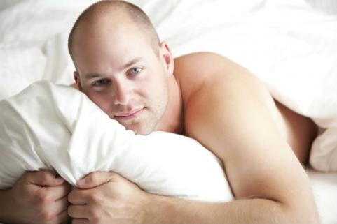 attractive bald man in bed