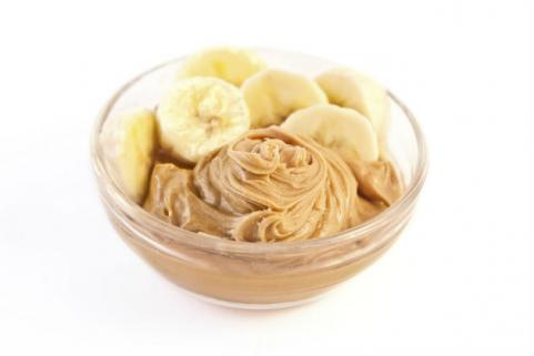 bowl of peanut butter and banana slices