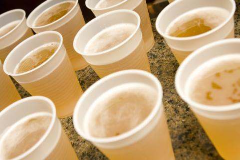 plastic cups of beer