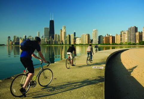man biking chicago shoreline