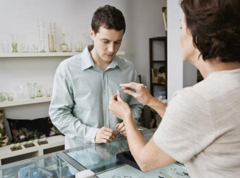 guy buying engagement ring from jeweler