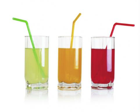three glasses of bright juice