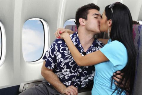 couple kissing on airplane