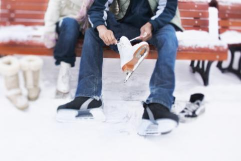 couple putting on ice skates