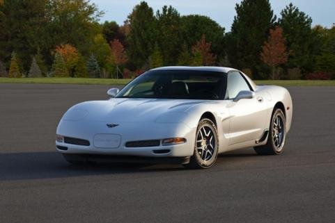 2001 White Corvette on the road