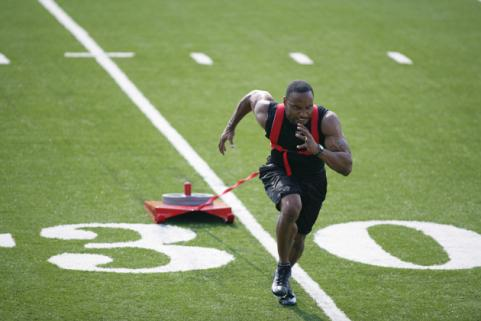 Man running with weighted sled
