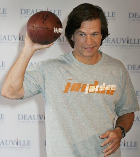 Mark Wahlberg with football at premiere of Four Brothers