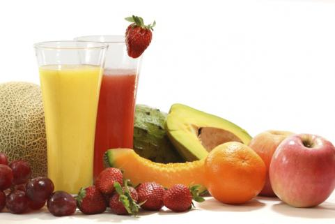 glasses of fruit juice with fruit