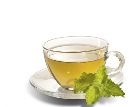 clear mug of green tea