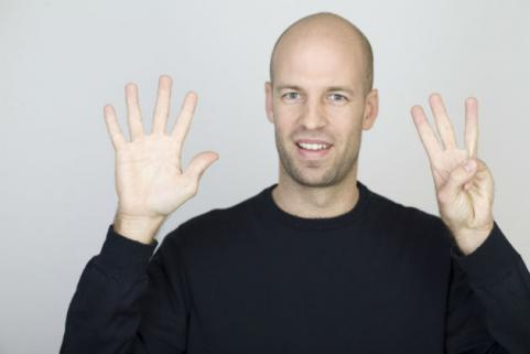 guy holding up eight fingers
