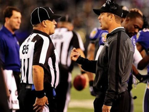 Jim Harbaugh challenges referee