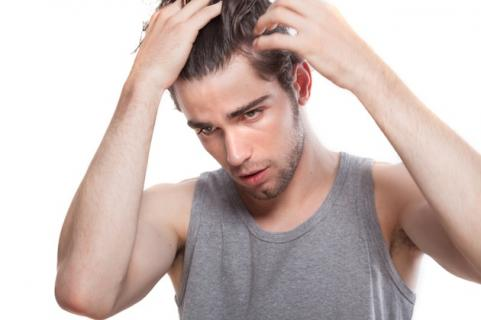 Man touching his hair
