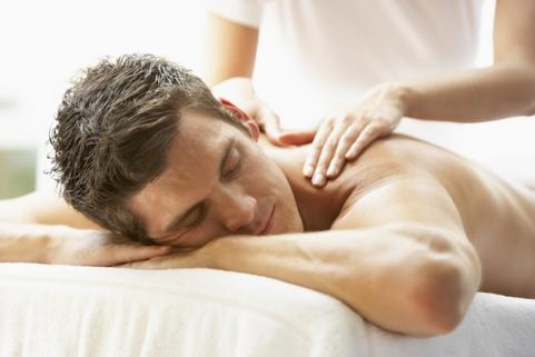 Man resting and recovering with a massage