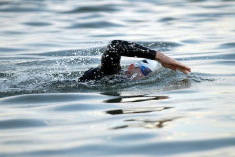 Triathlete doing open water swim