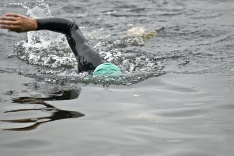 Triathlete swimming in lake