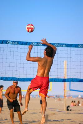 men-playing-beach-volleyball