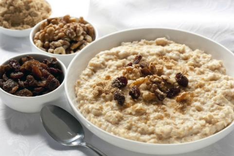 bowl of oatmeal with raisins and walnuts