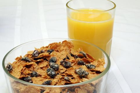 Bowl of raisin bran and glass of orange juice