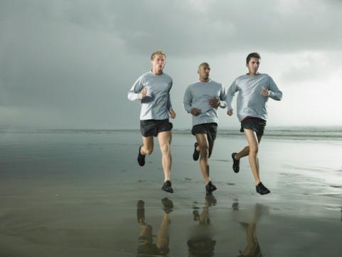 Men running together